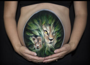 impact arts company maternity belly painting of lions